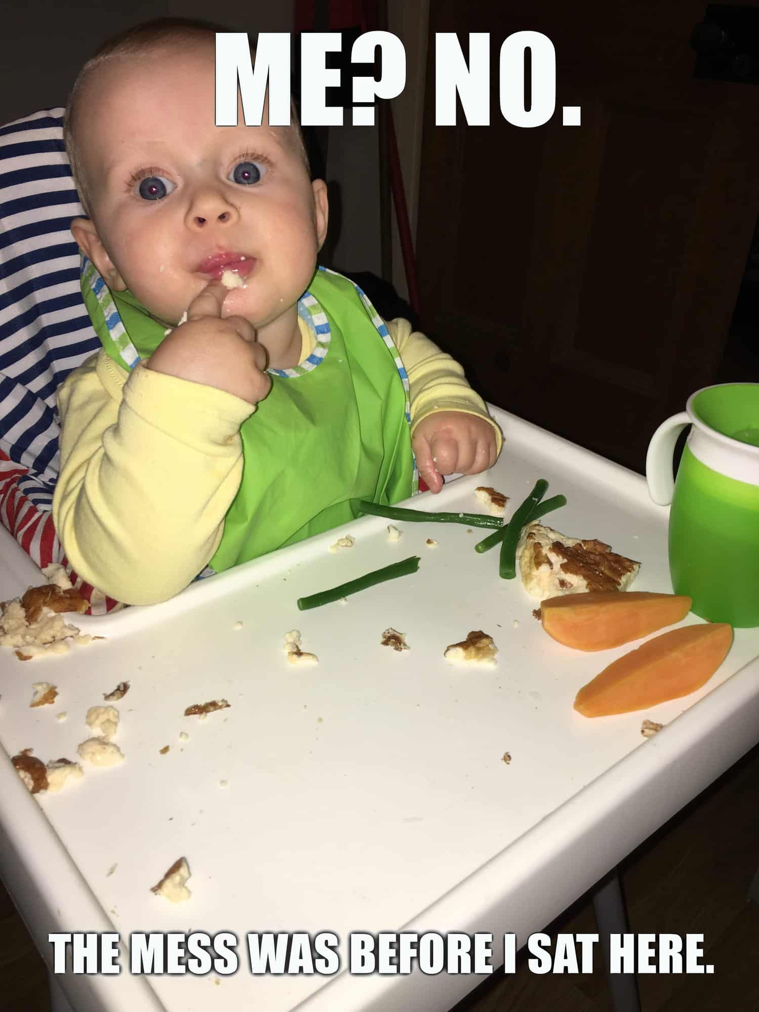 photo of baby in highchair. Caption: me? no. this mess was before I sat here.