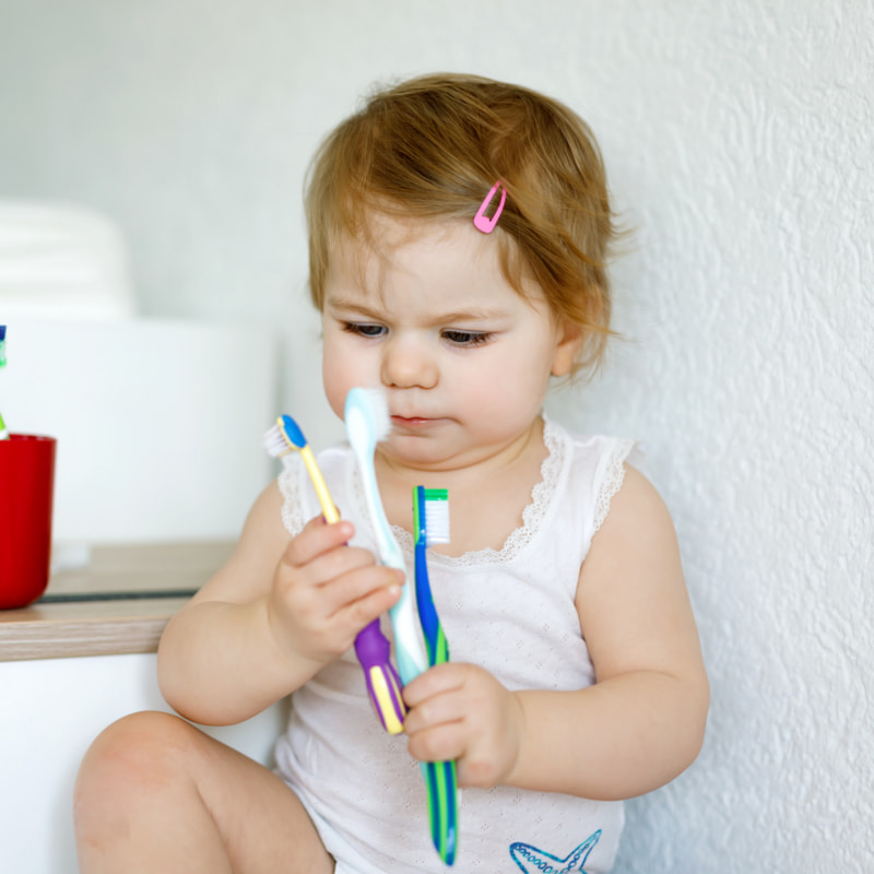 Toddler with brushes
