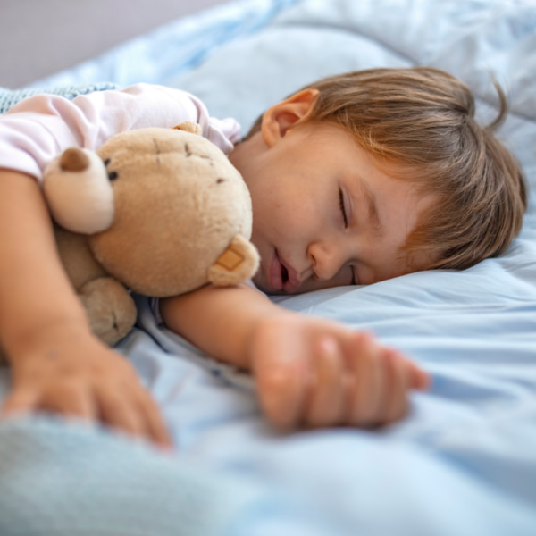 toddler sleeping with a teddy