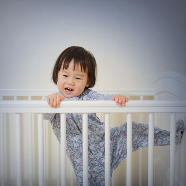 Photo of toddler in cot