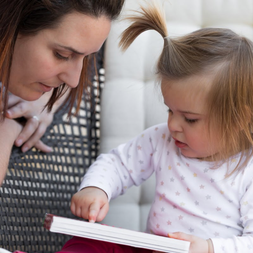 Photo of child being read to