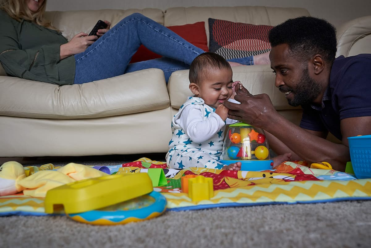 Photo of dad playing with baby