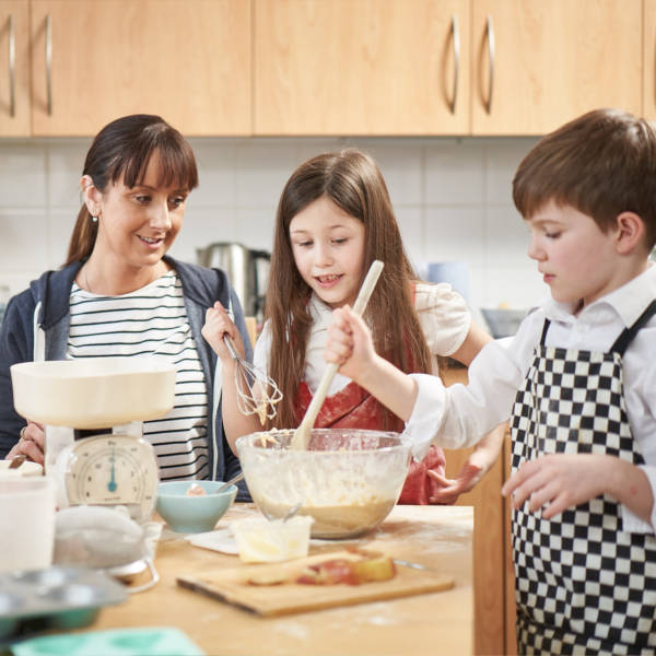 mum cooking with her two children