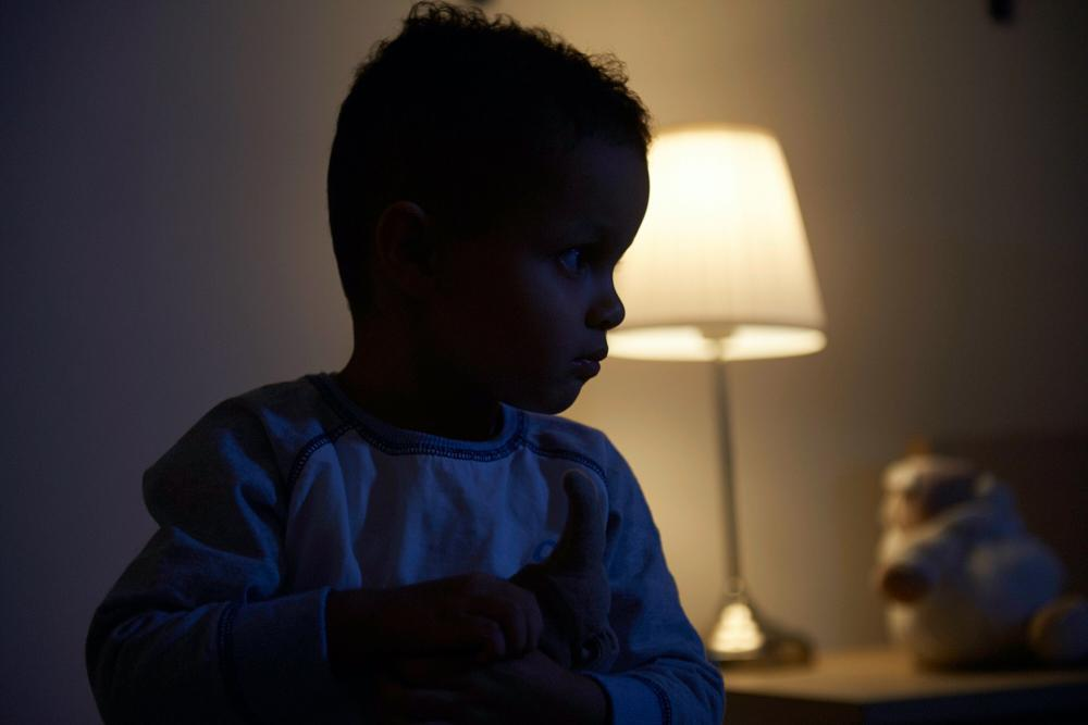 photo of toddler awake in the dark