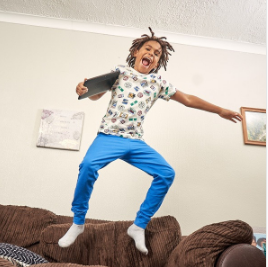 Photo of a boy jumping on a couch